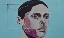 Мурал с портретом мужчины на Позняках