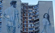 Мурал с юношей на проспекте Героев Сталинграда