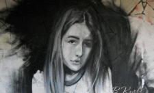 Стрит-арт с девушкой на улице Малышко
